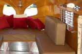 Wooden venitian blinds and wood ceiling in 1936 Airstream Clipper Trailer