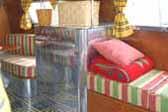 Vintage bedding and furnishings in amazing 1936 Bowlus Trailer