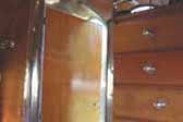 Classic wood cabinets with original metal trim in 1936 Bowlus Trailer