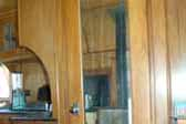 Original beveled mirror and woodwork in 1937 Pierce Arrow Travelodge trailer
