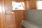 Original wood work and re-upholstered couch in 1937 Pierce Arrow Travelodge Trailer
