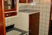Cool un-restored kitchen tile, cabinets and sink in 1937 Royal Wilheim Trailer