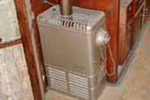 Photo shows original gas heater in 1937 Royal Wilheim Trailer living room
