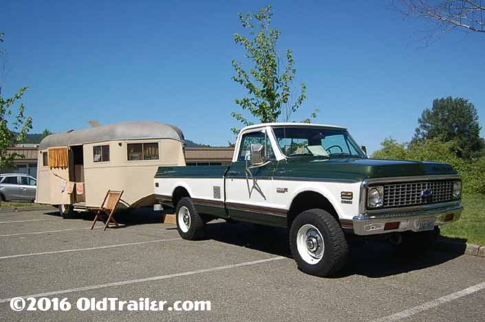 This vintage towing rig is a Chevy 4x4 pickup truck pulling a Vintage Vagabond Trailer