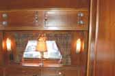Beautiful wood cabinetwork and dining table in 1938 Kozy Coach Trailer