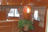 Detail photo of beautiful wood paneling and ceiling in 1938 Kozy Coach Trailer