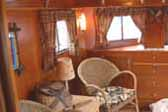 Vintage fishing creel and interior accessories in 1938 Kozy Coach Trailer