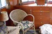 Beautifully furnished interior in 1938 Kozy Coach Trailer living room