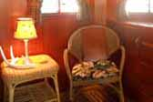 Wicker chairs and designer furnishings in restored 1938 Kozy Coach Trailer