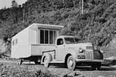 Photo shows the rear end of a beautifully restored 1949 Vagabond trailer