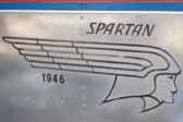 Faded Spartan logo graphics painted on the side of a 1946 Spartan Manor trailer