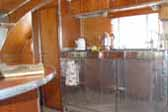 Photo of amazing stainless steel kitchen cabinets in vintage 1947 Aero Flite Trailer