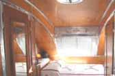 Picture shows beautiful bedroom in restored 1947 Aero Flite Trailer
