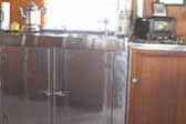 Picture of kitchen woodwork and stainless steel counters in 1947 Aero Flite Trailer