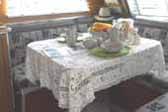 Photo of decorated dining table in vintage 1947 Aero Flite Trailer