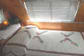 Picture shows elegant vintage chenille bedspread in 1947 Aero Flite Travel Trailer