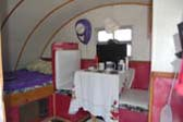 Interior of 1947 Komfort Koach Teardrop Trailer, Showing Bed And Dining Area