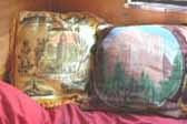 Vintage souvenir pillows in 1948 Boles Aero Trailer bedroom