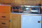 Photo shows restored kitchen cabinets and fridge in 1948 Boles Aero Trailer