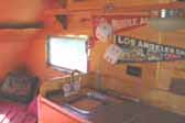 Photo of cozy bedroom area off kitchen in vintage 1948 Boles Aero Trailer