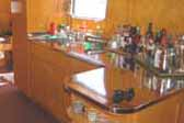 Photo of golden kitchen cabinetry in restored 1948 Spartan Manor Trailer