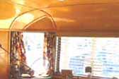 Photo of amazing ceiling wood paneling in 1948 Spartan Manor Trailer dining room