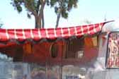 Photo of a 1948 Spartan Manor trailer with a bold red and yellow striped awning
