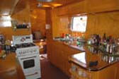Spectacular Kitchen Stove and Stainless Countertop in 1948 Spartan Manor Trailer