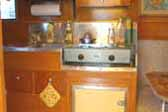 Kitchen cabinets and stainless steel countertop in restored 1948 Terry Rambler Trailer