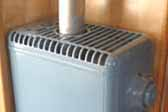 Photo of vintage Duo-Therm gas heater in 1948 Westcraft Sequoia Trailer