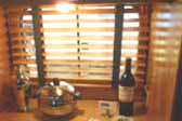 Photo shows elegant wooden venetian blinds in a 1948 Westcraft Sequoia Trailer