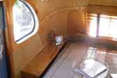 Photo of glowing woodwork in 1948 Westcraft Sequoia Trailer back bedroom