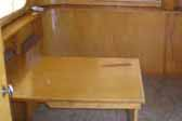 Photo of original woodwork and folding table in 1948 Westcraft Westwood trailer