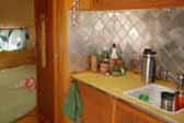 Photo of kitchen cabinets and tile back-splash in restored 1949 Star Trailer