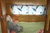 Picture shows cozy bedroom at rear of 1949 Star Vintage Trailer
