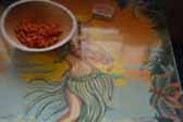 Detail photo of Hula Girl artwook on dining table in 1949 Star Trailer