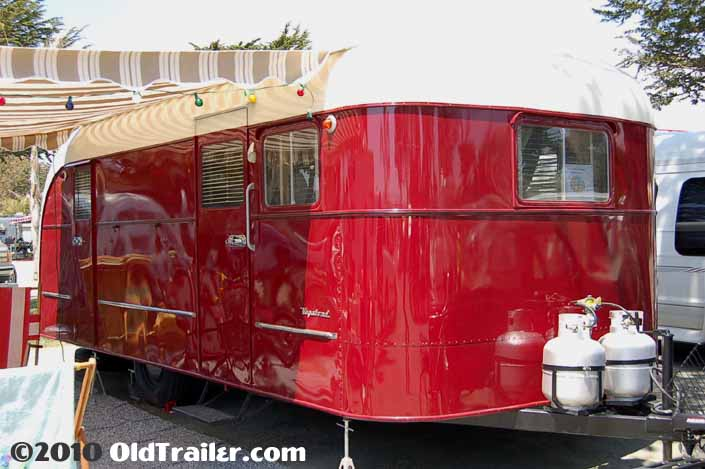 Photo of a vintage 1949 Vagabond trailer with red and cream paint job