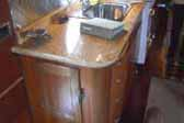 Beautifully restored galley cabinet workwork and stone countertop in 1950 Airfloat LandYacht vintage trailer