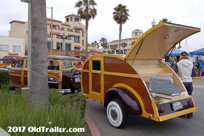 This vintage towing rig is a 1950 plymouth woodie wagon pulling a woodie teardrop trailer