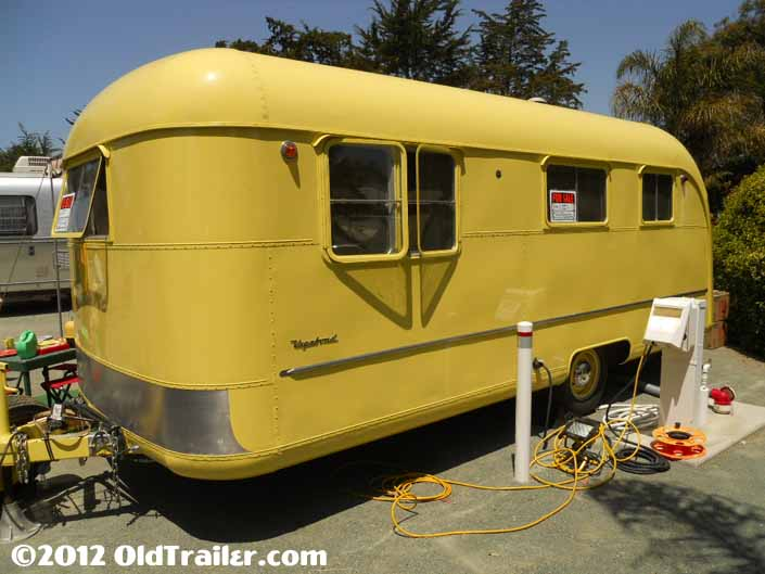 This 1950 Vagabond model 19 trailer has a lemon yellow paint job