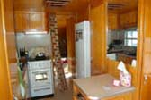 Warm & Glowing Interior Cabinetry in 1951 Spartanette Tandem Trailer