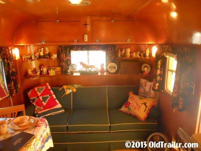 This 1951 Vagabond trailer has a cozy sofa in the living room area