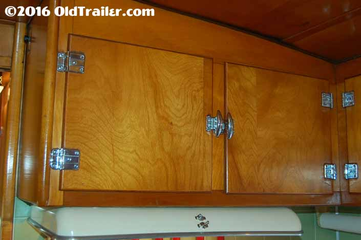 This 1951 vagabond trailer has kitchen cabinets with the original hinges and latches