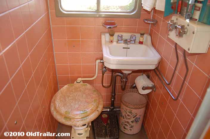 Photo shows a 1951 Vagabond trailer with a vintage toilet and bathroom