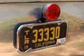 Rare vintage california trailer license plate on a restored 1953 Aljoa vintage Travel Trailer
