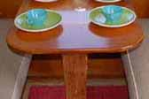 Rare all wood vintage dining table in a 1954 Shasta 1400 Travel Trailer