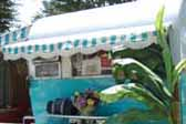 1955 Aljoa trailer with great beach-vide turquoise and white stripped side and front canvas awnings