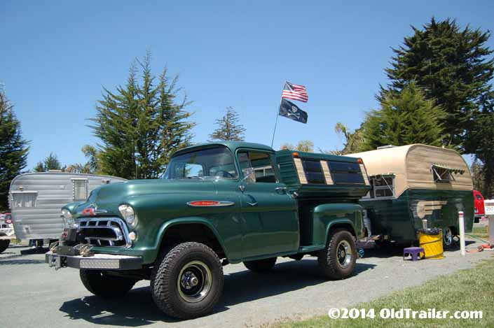 This vintage towing rig is a chevy stepside pickup truck pulling a vintage 1955 Aljoa trailer