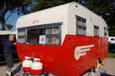 Photo of gorgeous red and white 1955 vintage Aljoa travel trailer