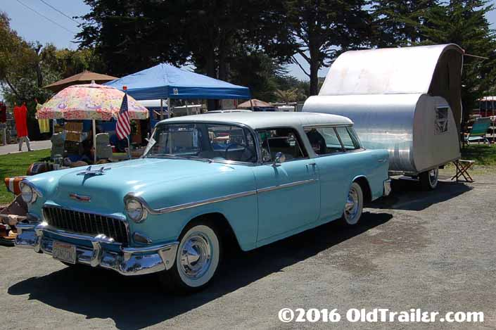 This vintage towing rig is a vintage 1955 chevy nomad station wagon pulling a vintage teardrop trailer